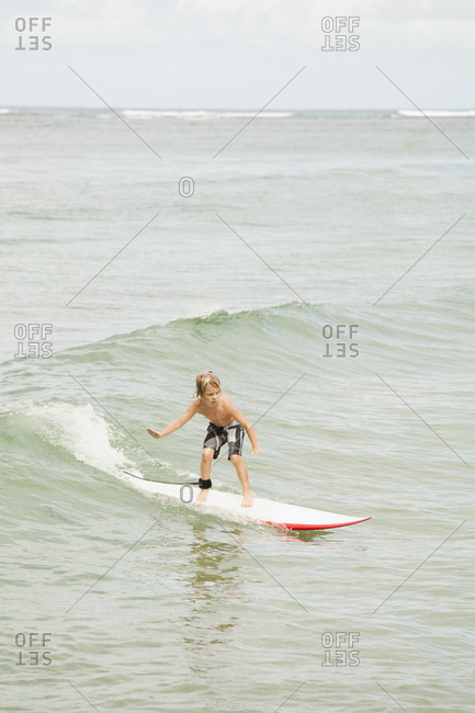 Boy (6-7) surfing