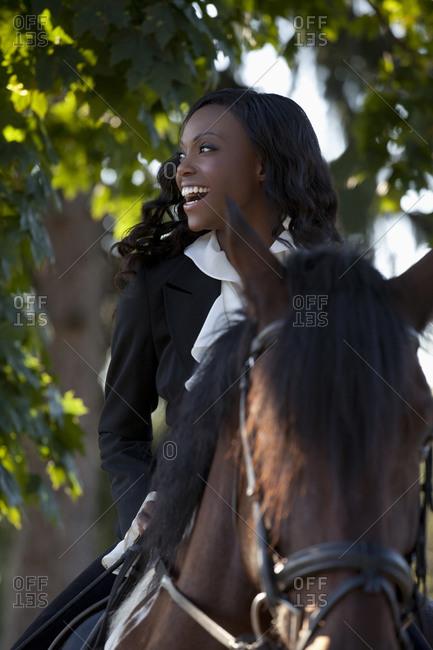 Beautiful woman horseriding