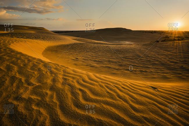 Sunrise over sand dunes - Offset