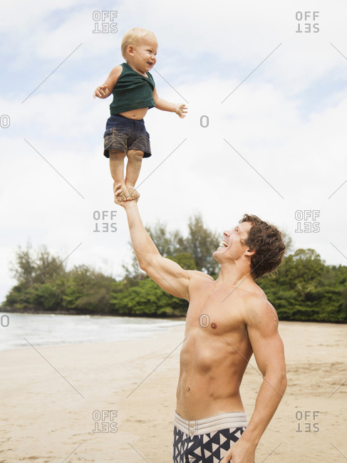 Father with son (6-11 months) on beach