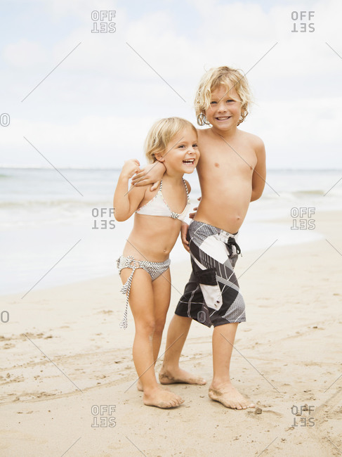 Laughing sibling on beach