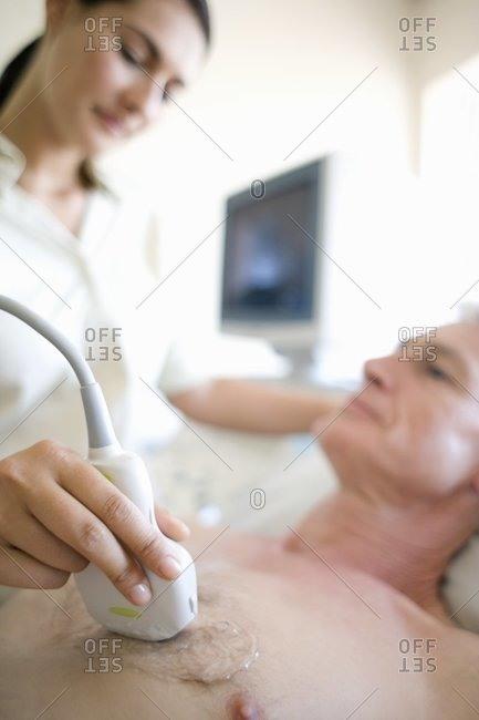 Senior patient undergoing a heart ultrasound scan, Echocardiography