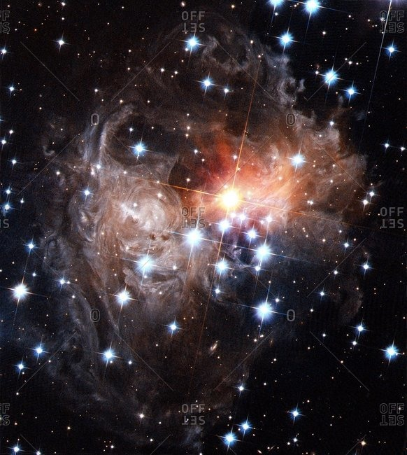 Light echoes around star V838 Monocerotis, Hubble Space Telescope image. This star underwent a massive brightening, or nova, in 2002. The light released by this event has illuminated a series of shells of gas and dust that surrounded the star.
