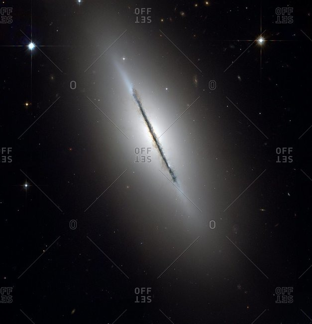 Spindle galaxy (NGC 5866), optical image, Hubble Space Telescope image. This lenticular (disc-shaped) galaxy lies around 44 million light years from Earth in the constellation Draco.