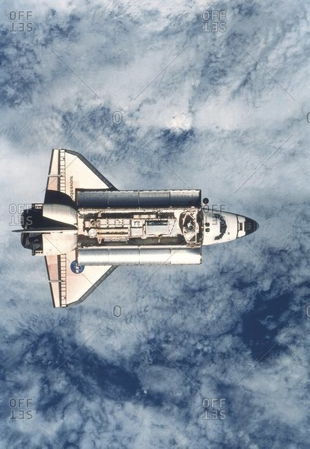 View from the International Space Station (ISS) of the approaching Space Shuttle Endeavour. In the shuttle's open cargo bay are parts for the ISS.