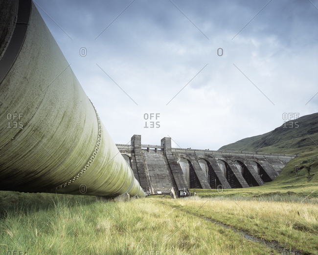 Hydroelectric dam and pipeline at a hydroelectric power station, Perthshire, Scotland, UK.