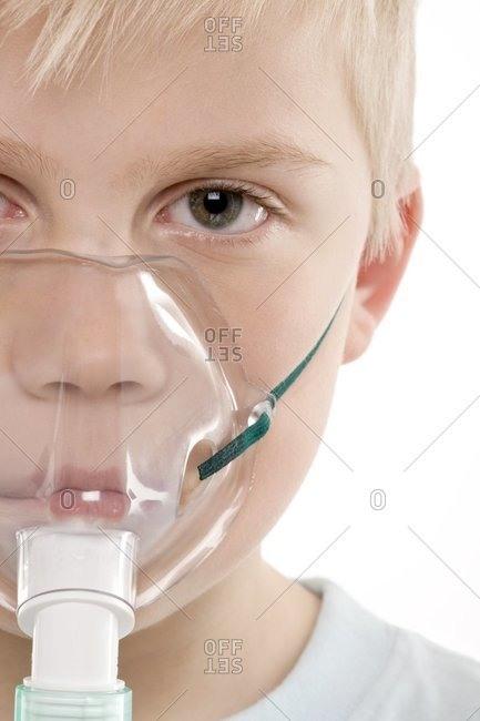 Boy using a nebulizer to treat asthma.