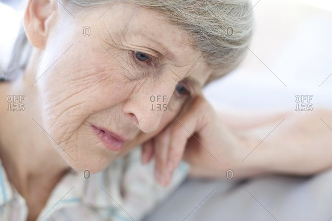Depressed woman resting her head on her hand