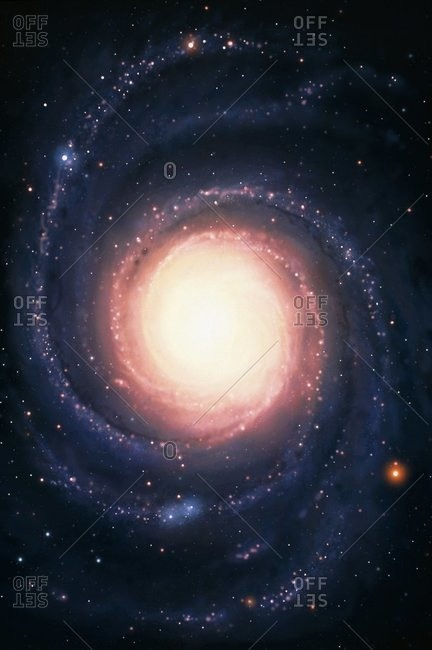 Spiral galaxy with a yellow nucleus (center) surrounded by its spiral arms.