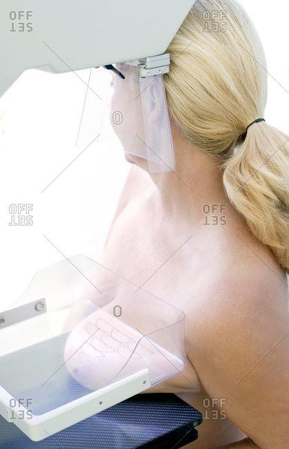 A woman undergoing a Mammography.