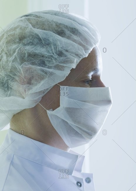 Doctor in surgical mask and cap