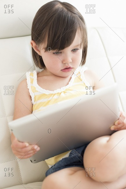 Toddler using a tablet computer.