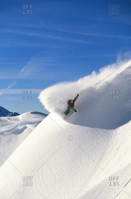 Snowboarder on mountain snowboarding