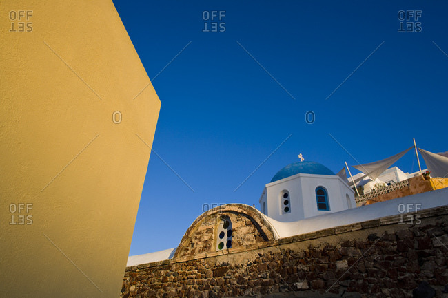 Detailed view of yellow church with blue sky
