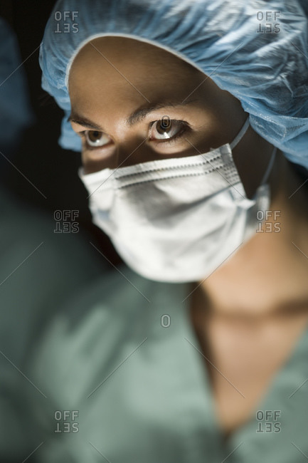 Woman in surgical scrubs looking up