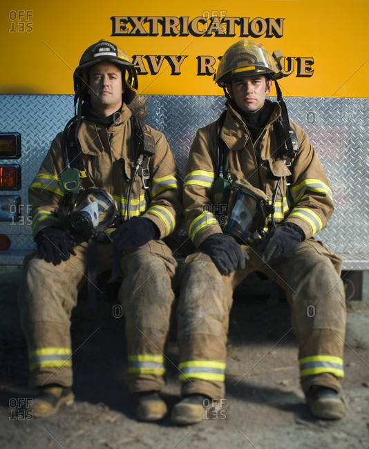 Portrait of two firefighters