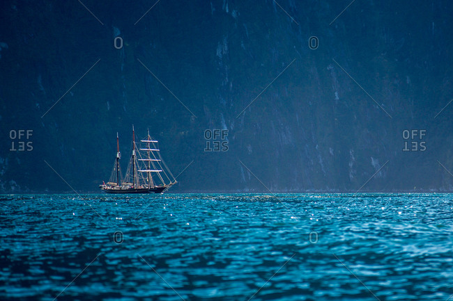 Tall ship sailing on calm water