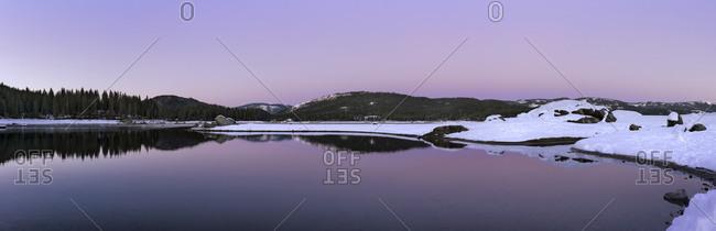 Sunrise over still rural lake, North Fork, California, United States
