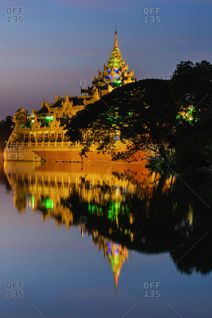 Ornate building reflected in still water