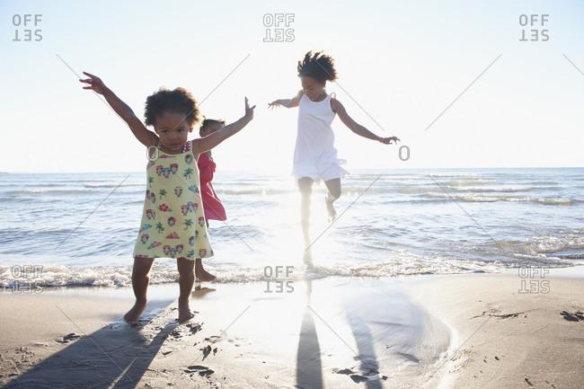 Black girls playing on beach
