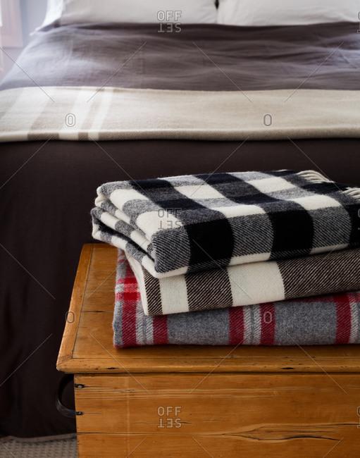 Stack of three warm, soft blankets