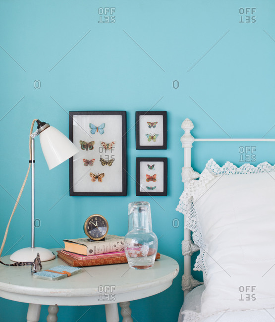 Shabby chic bedroom interior with items on bedside table
