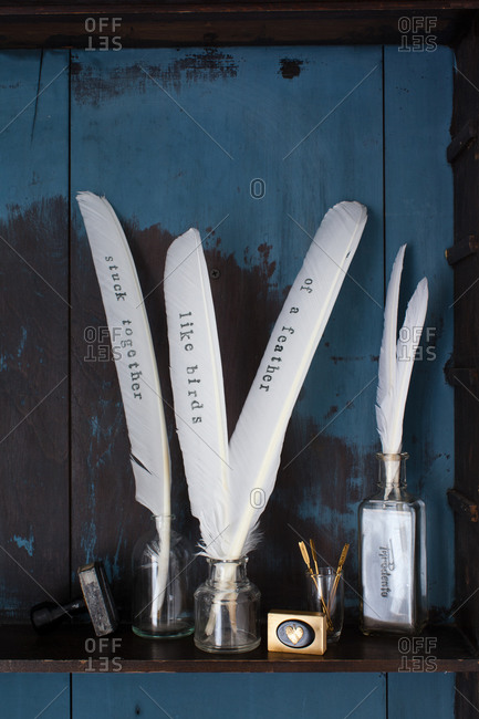 White quill pens in glass jar