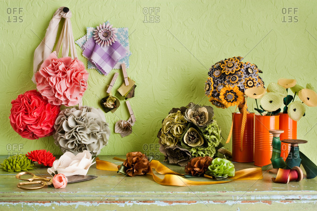 Different fabric flowers on table
