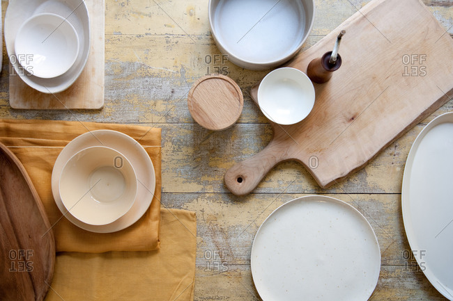 Top view of empty plates on wooden table