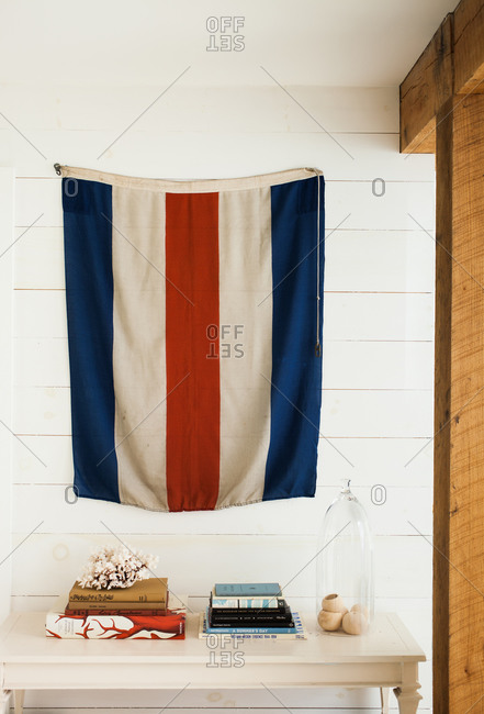 Colorful flag hanging above white table