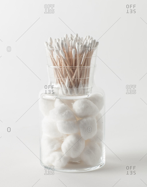 Cotton swabs and cotton balls in glass containers