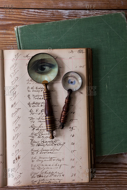 Old magnifying glasses on opened notebook
