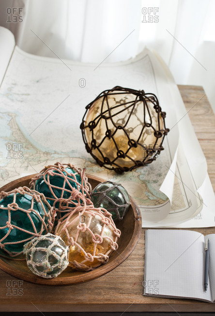 Paperweight on old maps