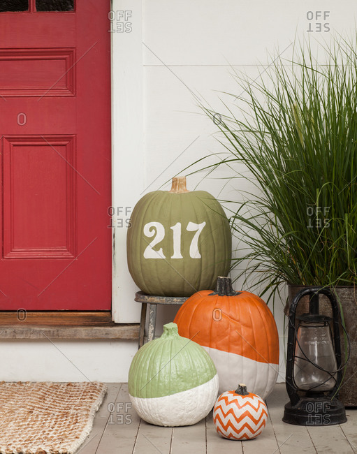 Painted pumpkins on the porch