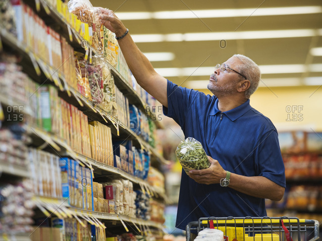 African American man shopping in grocery store