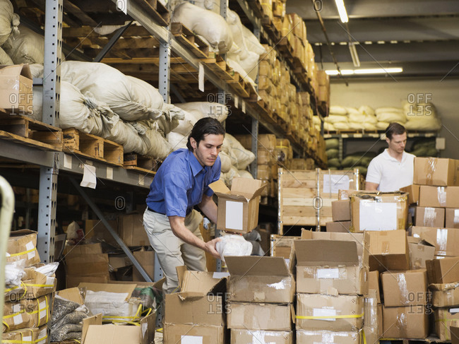 Workers stacking boxes in textile factory