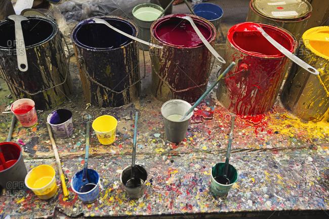 Buckets of paint in studio