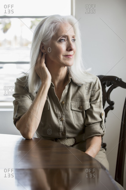 Older Caucasian woman sitting at table