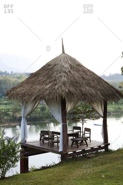 Tables on gazebo overlooking river