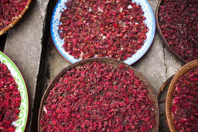 Baskets of drying hibiscus tea