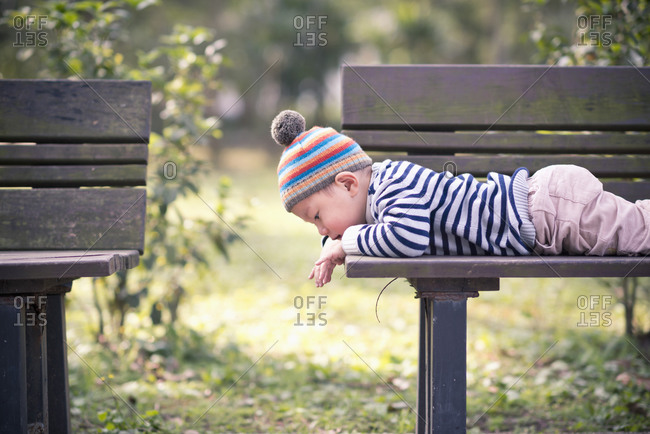 Child on a park bench