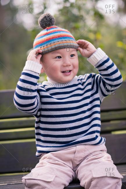 Child on a park bench
