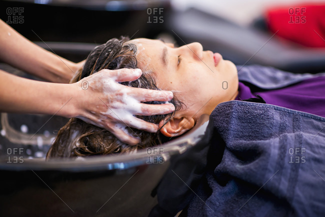 Young woman getting her hair washed