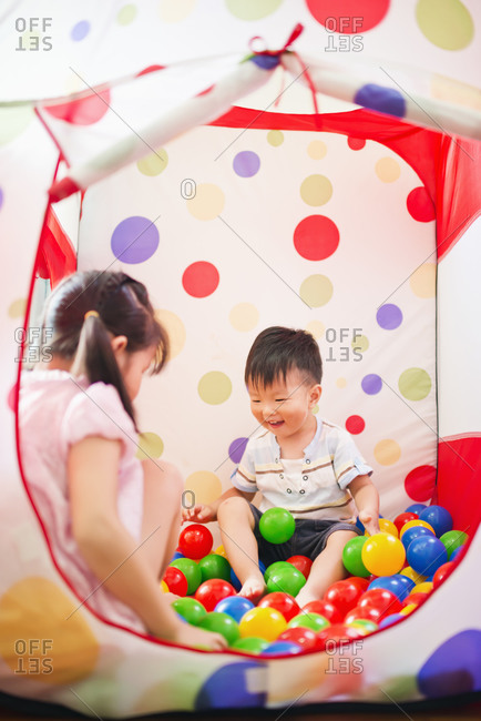 Children in tent with colored balls