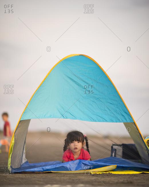 Little girl lying in tent