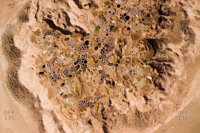 "Colorful ""cobblestone"" salt wells in Tegguiada-n-Tessoum"
