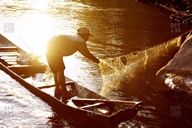 A boy fishing, Pak Ou, Laos