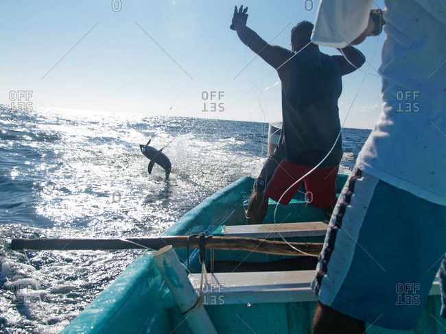 Hand lining for tuna in the Pacific off the coast of Puerto Angel