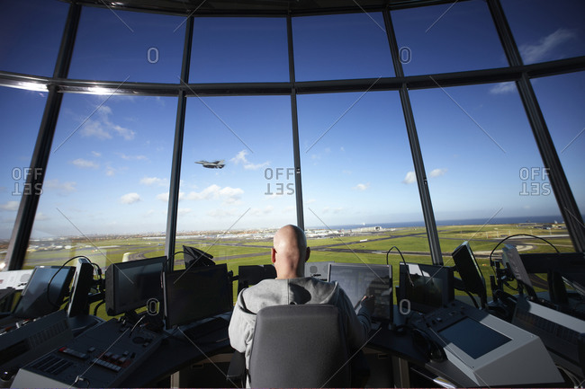 Controller in Copenhagen Airport, an F16 fighterjet passing by