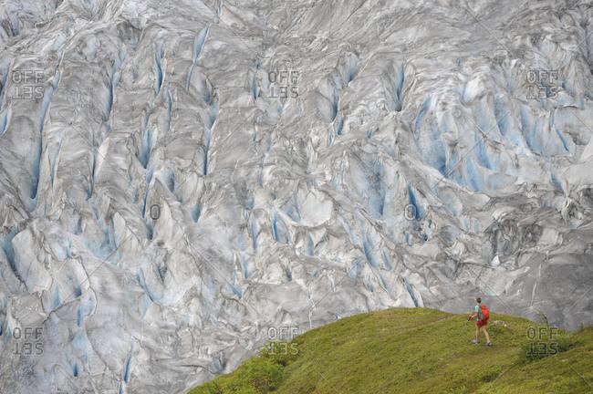 Backpacker hikes the Harding Icefield Trail in Kenai Fjords National Park near Seward, Alaska.